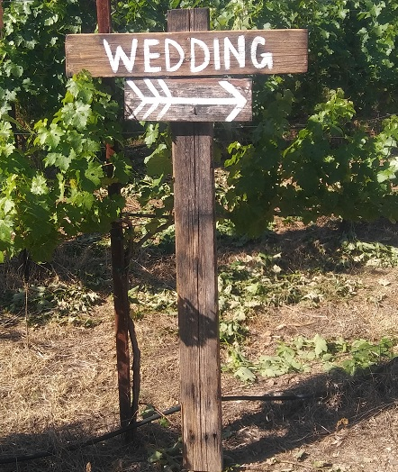 Wooden sign With Wedding Arrow rentals from Brave Horse Winery